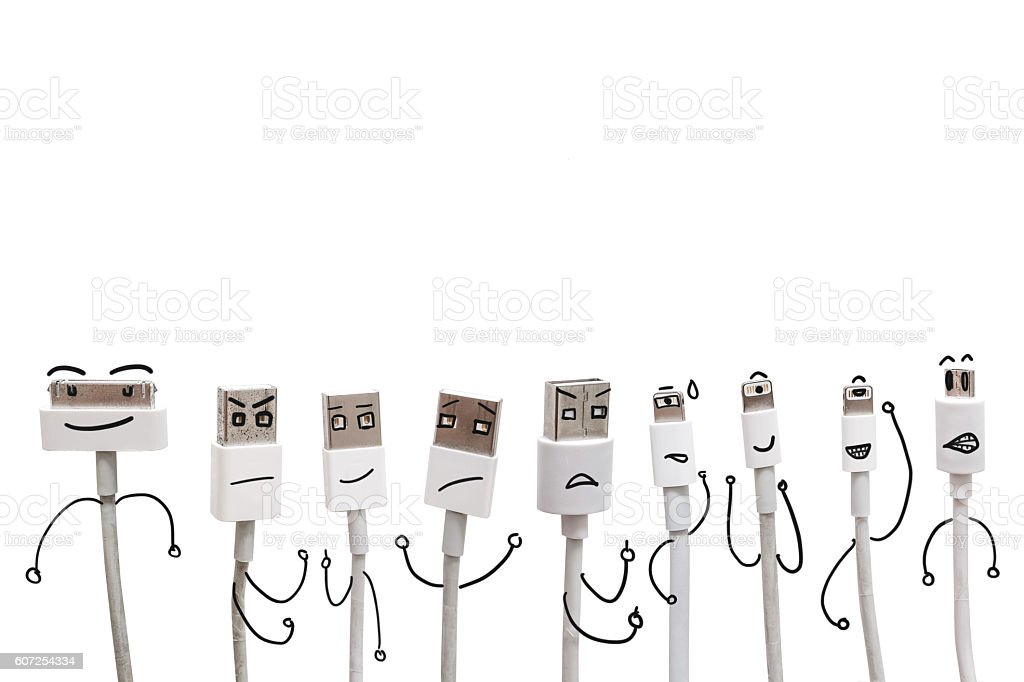 Various USB cable ports with funny cartoon character face, isolated stock photo