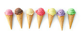 Various varieties of ice cream in cones isolated on white background