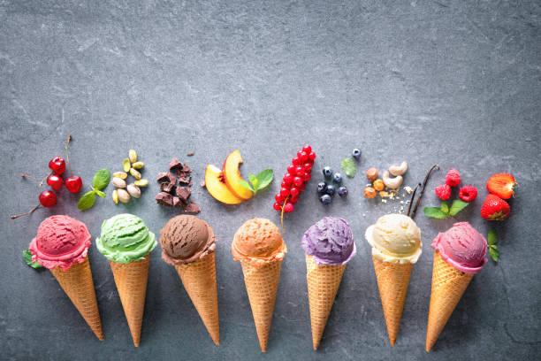 Various varieties of ice cream in cones stock photo