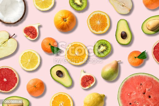 istock Various vegetables and fruits on pink background, top view, flat layout. Food vegan concept. 1060568536