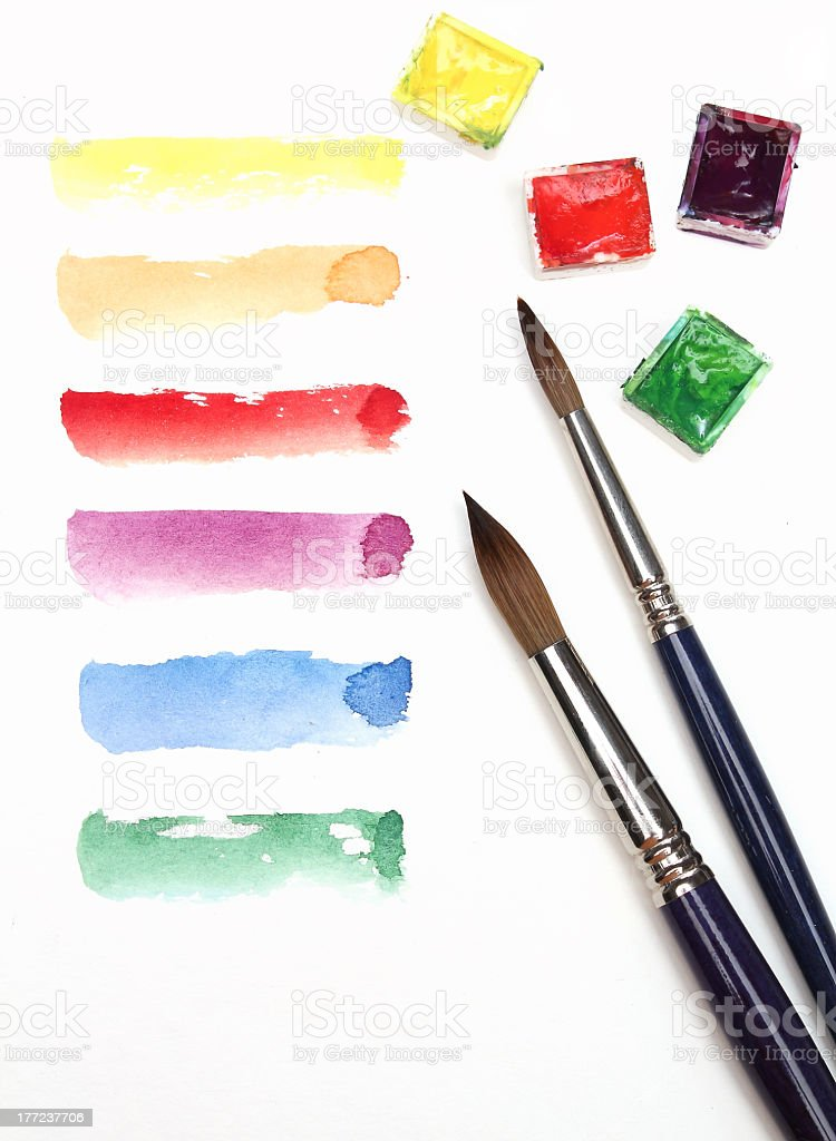Various watercolor strokes with paintbrushes on white royalty-free stock photo