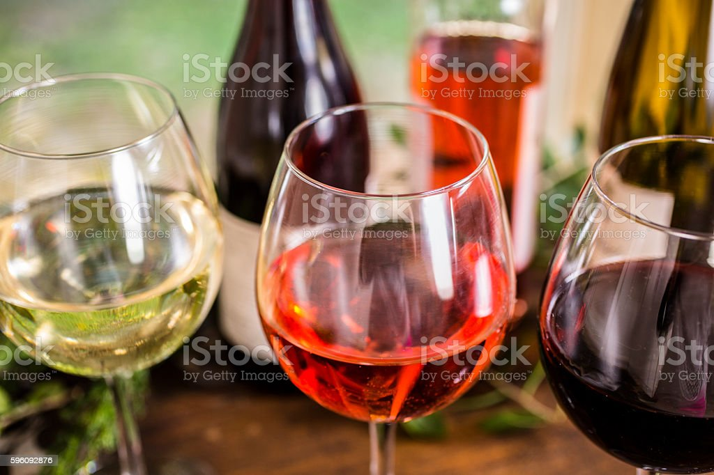 Various wine selections, glasses on outdoor dining table. Lizenzfreies stock-foto