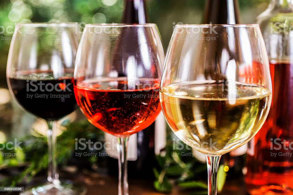 Various wine selections, glasses on outdoor dining table. stock photo