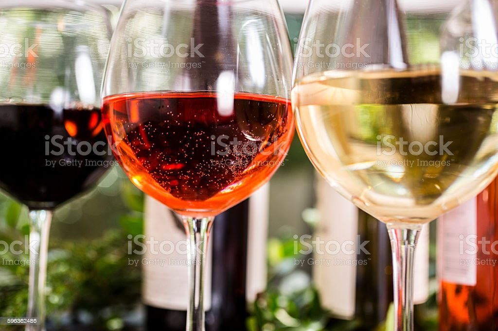 Various wine selections, glasses on outdoor dining table. royalty-free stock photo