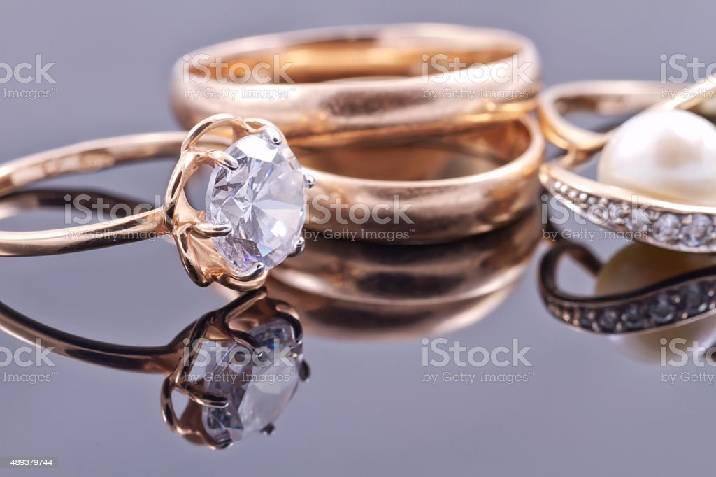 Various women's gold rings stock photo