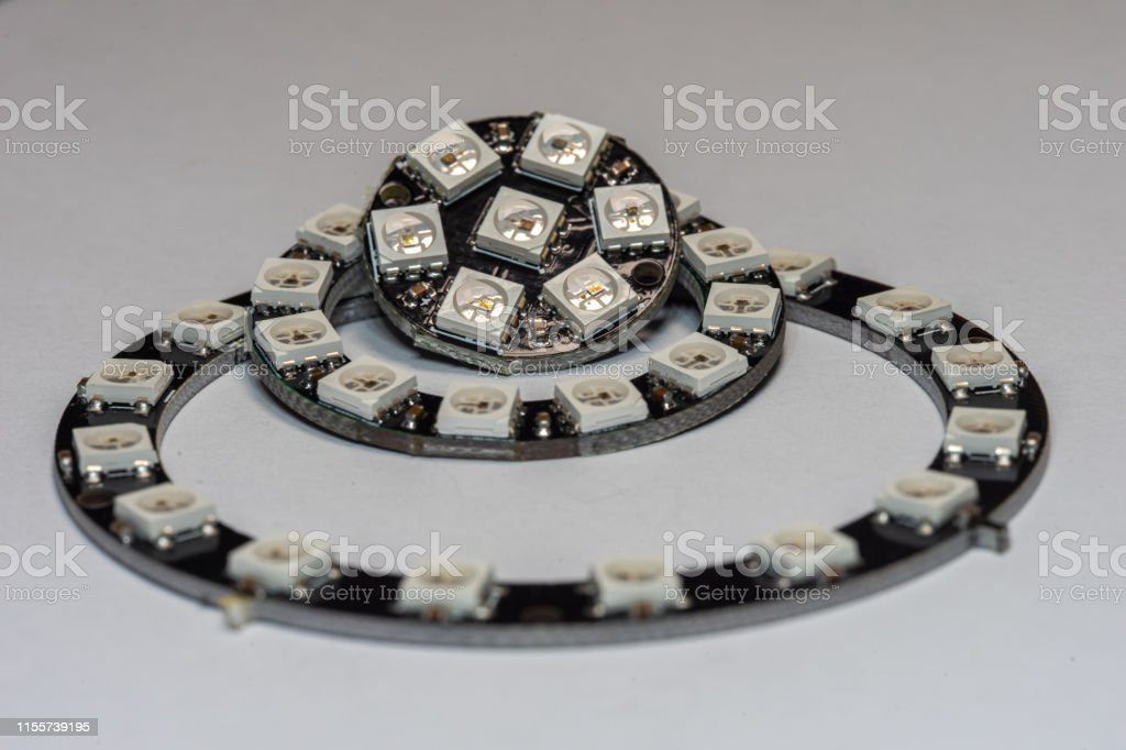 Various WS2812 RGB Addressable LED Rings Various WS2812 RGB Addressable LED Rings on a isolated background. Backgrounds Stock Photo