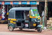 Varkala, India - October 15, 2015: Auto rickshaw in Varkala. Auto rickshaws are used in cities and towns for short distances and they provide cheap and efficient transportation.