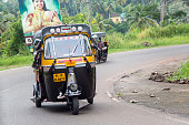Varkala, India - October 18, 2015: Auto rickshaw in Varkala. Auto rickshaws are used in cities and towns for short distances and they provide cheap and efficient transportation.