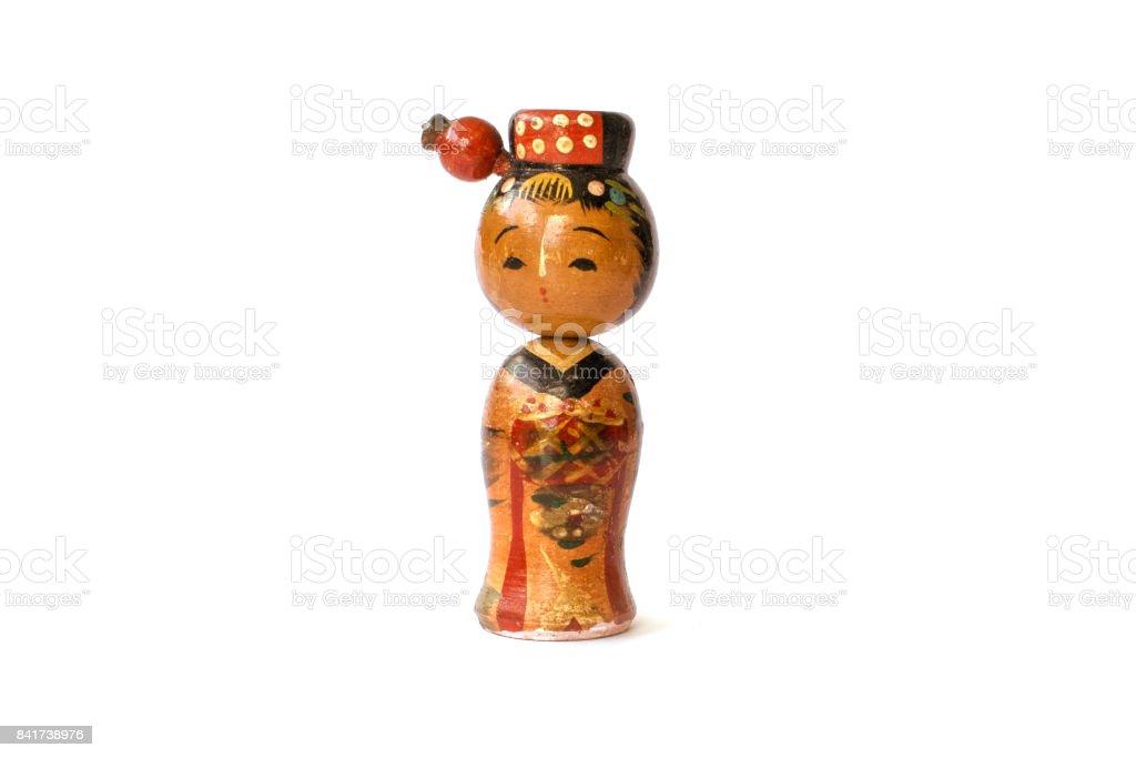Varnished wood kokeshi doll isolated on white background. stock photo