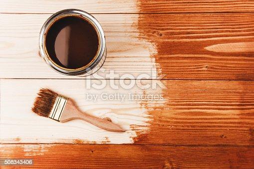 istock Varnishing a wooden shelf 508343406