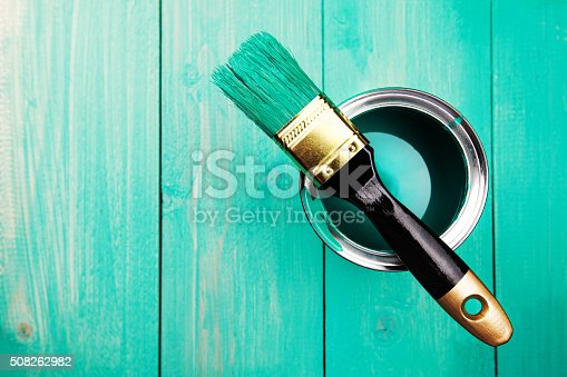 istock Varnishing a wooden shelf using paintbrush 508262982