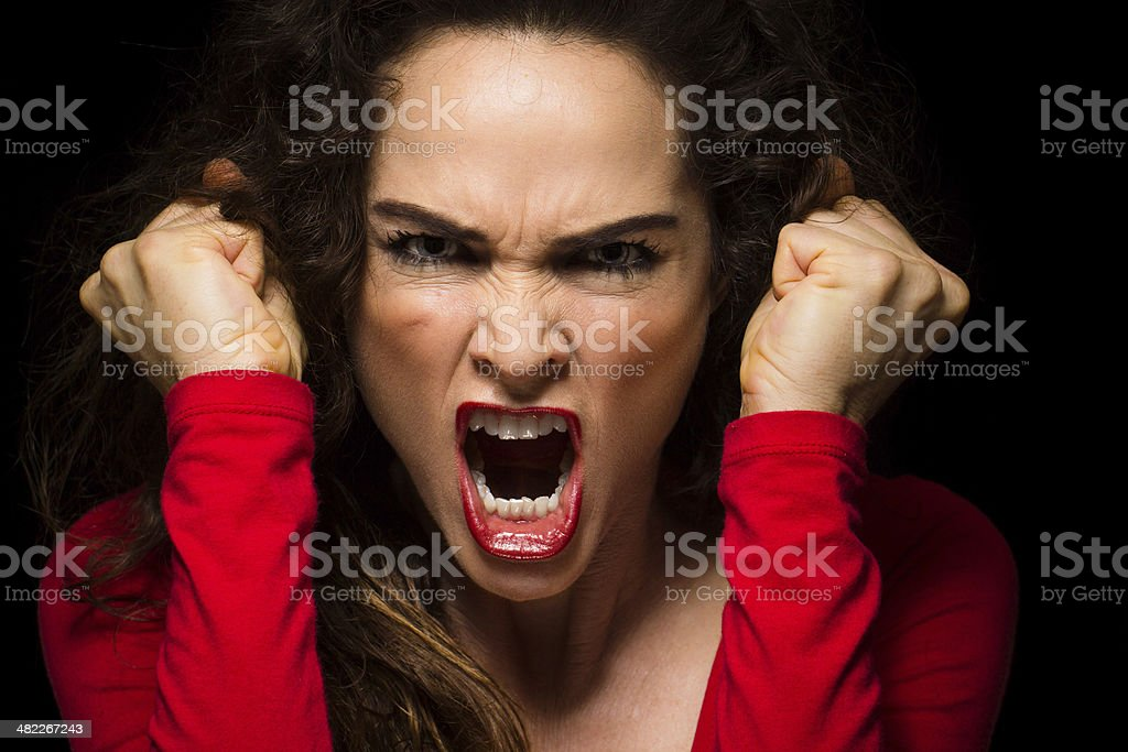 Vary angry woman clenching fists stock photo