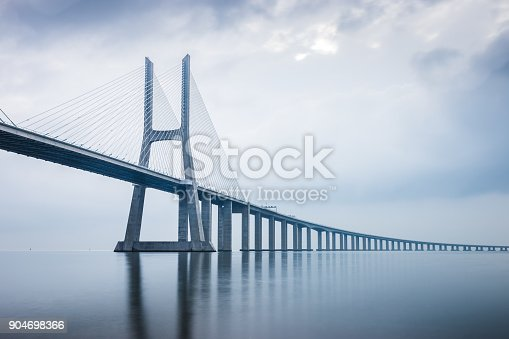 istock Vasco da Gama Bridge at sunrise in Lisbon, Portugal. he longest bridge in Europe 904698366