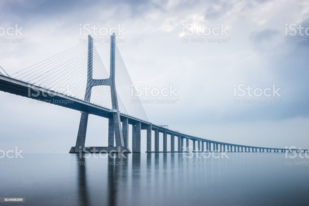 Vasco da Gama Bridge at sunrise in Lisbon, Portugal. he longest bridge in Europe stock photo