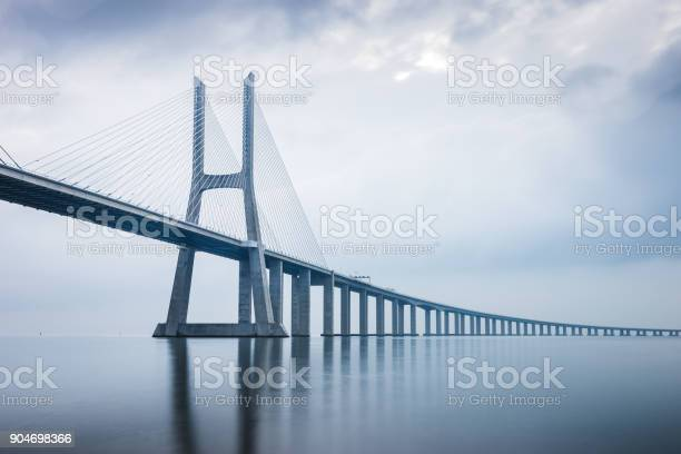 Photo of Vasco da Gama Bridge at sunrise in Lisbon, Portugal. he longest bridge in Europe