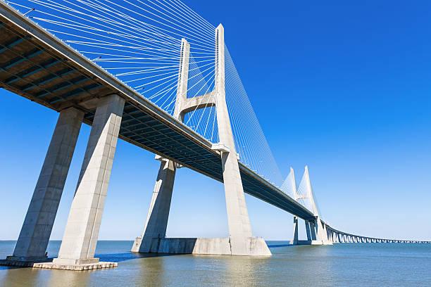vasco da gama bridge - bridge stok fotoğraflar ve resimler