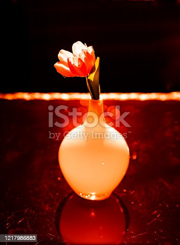 Vase and artificial flowers on the table