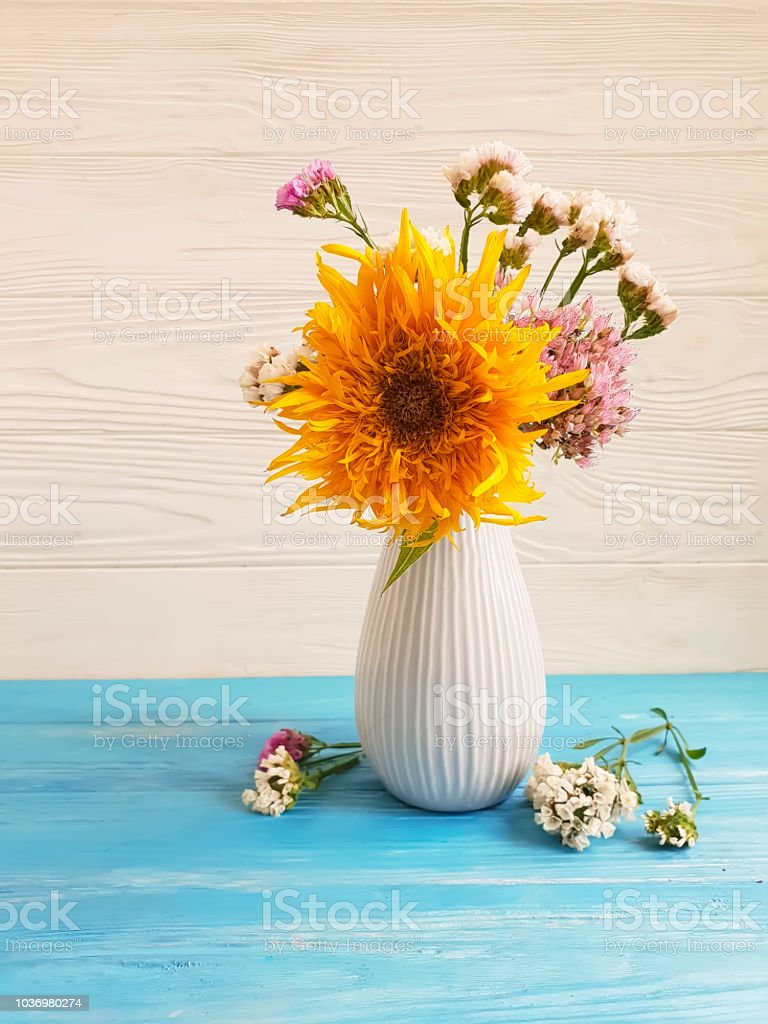 vase autumn flowers, sunflower on a wooden background