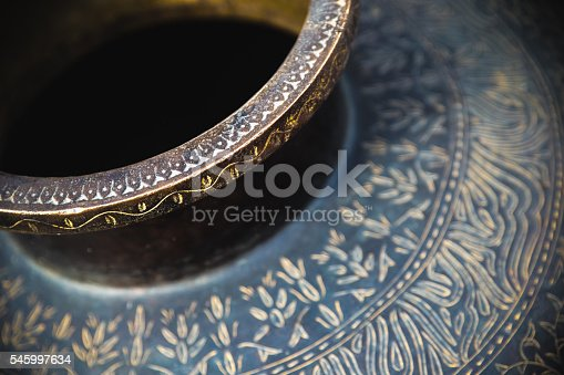 Close-up shot of a vase and its detailed patterns, as seen in Agra, India.