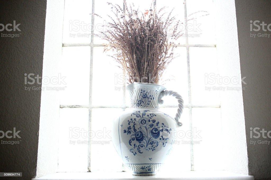 Vase in a window stock photo