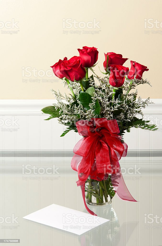 Vase of Roses and a Card royalty-free stock photo
