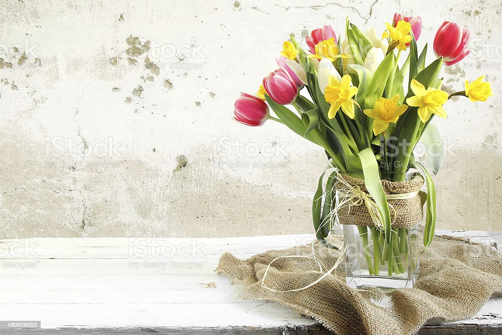 Vase of Tulips and easter eggs stock photo