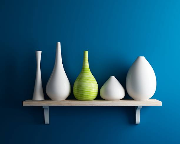 vase on shelf with blue wall interior stock photo