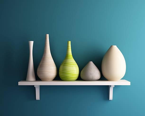 vase on white shelf with blue wall stock photo