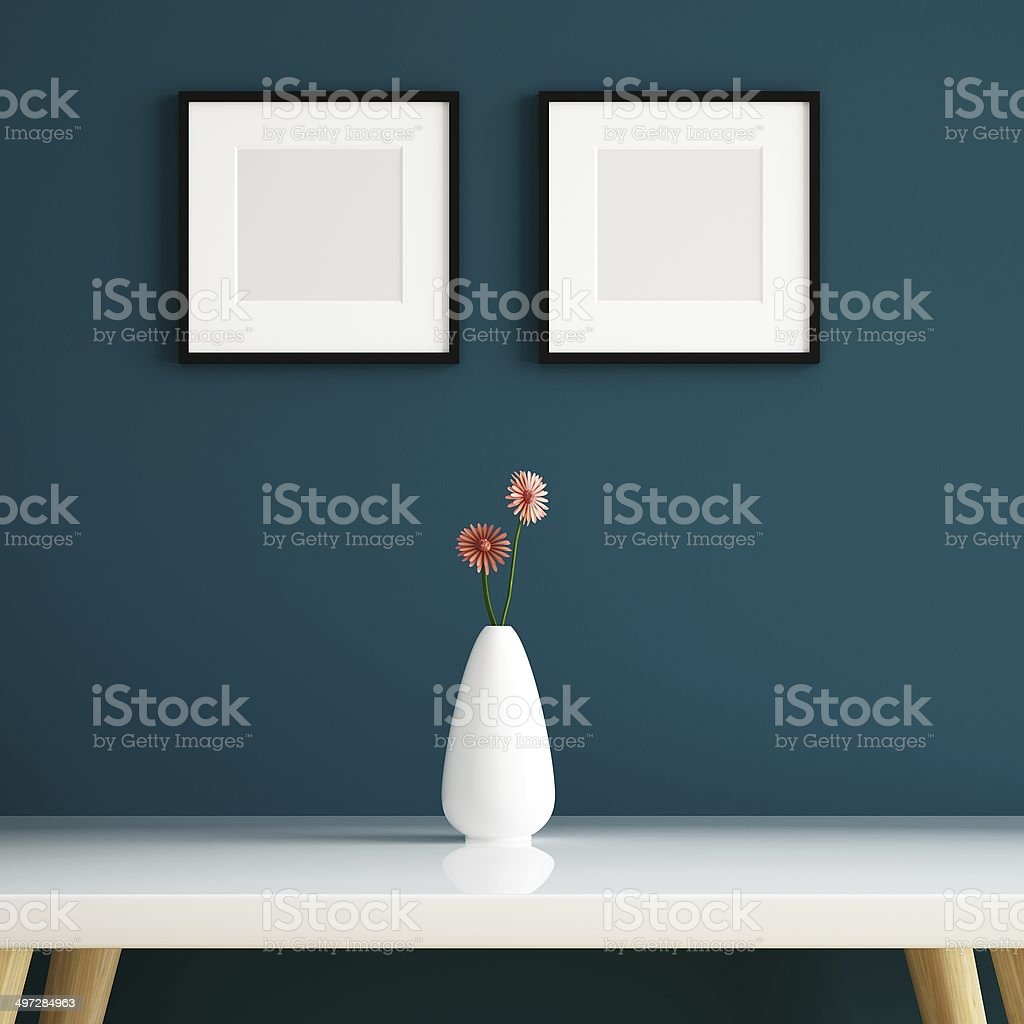 Vase on white table and picture frame decorated stock photo