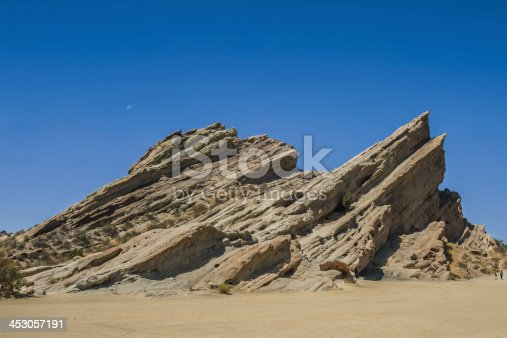 Iconic Californian rock formation located in the Los Angeles vicinity. Vasquez Rocks was background to  a great number of Hollywood productions. The tilted rock slabs protruding from the desert floor contrast with the dry chaparral that surround it.