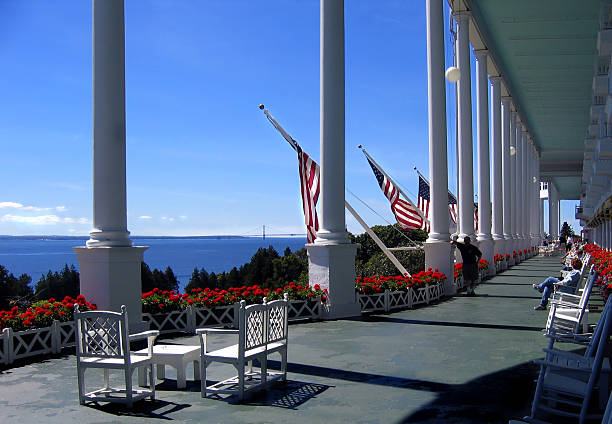 vast front porch of the grand hotel - mackinac island stock photos and pictures