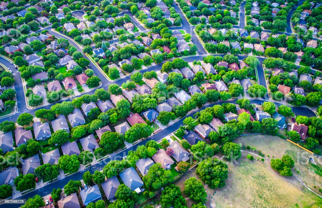 Vast Homes and Thousands of Houses Modern Suburb Development curves layout stock photo