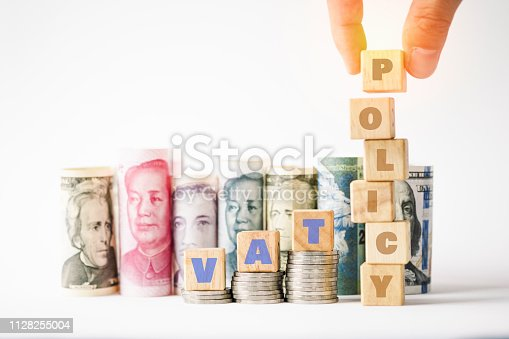 1024130248 istock photo Vat policy keywords on wooden cubes stack on coins and variety banknote background such as Yuan US dollar.Vat policy in each countries concept. 1128255004