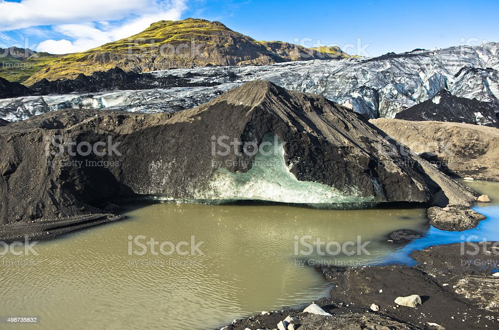 Vatnajokull glacier covered with volcanic ash is melting stock photo