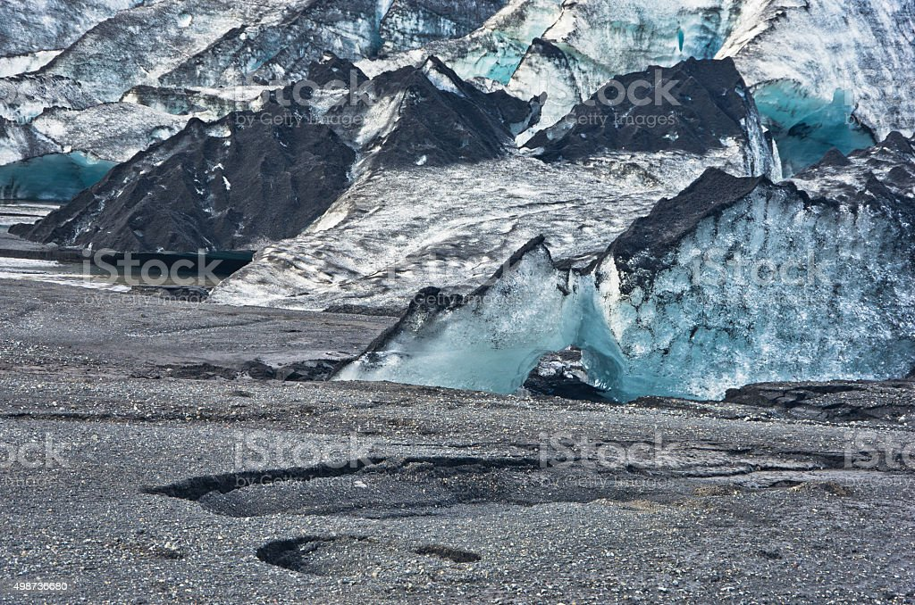 Vatnajokull glacier detail covered with volcanic ash is melting stock photo