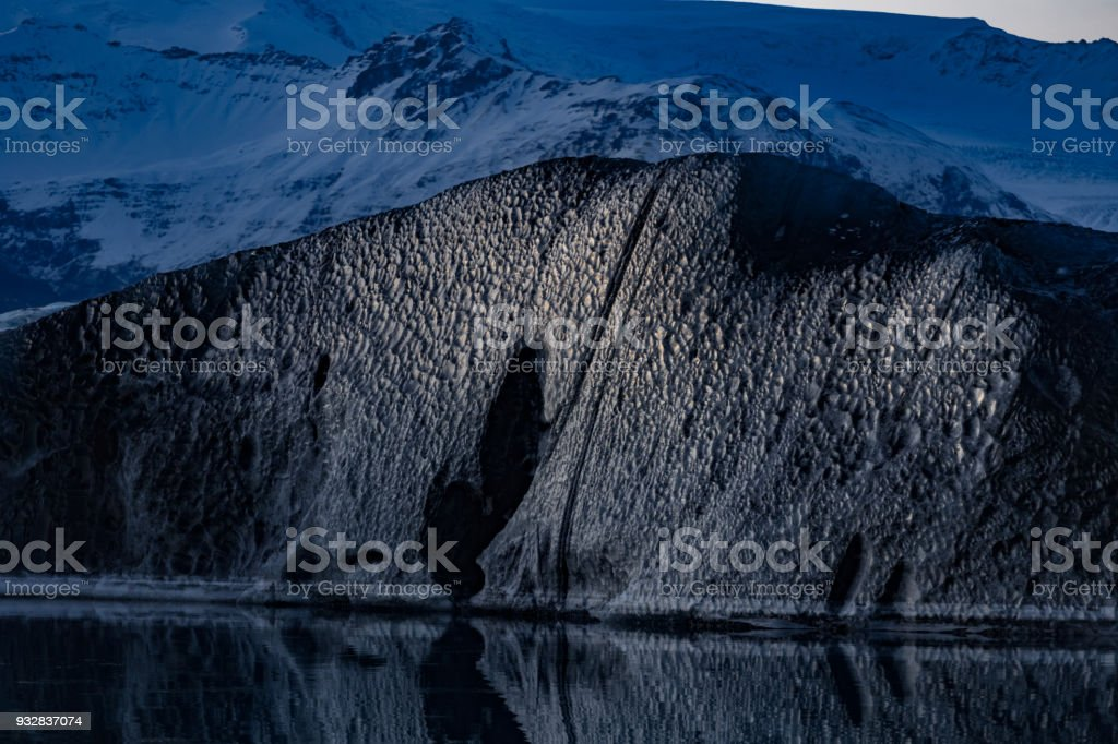 Vatnajokull lagoon black iceburg with reflection stock photo