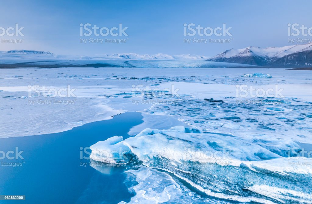 Vatnajokull lagoon  iceburg with moutains and glacier in background stock photo