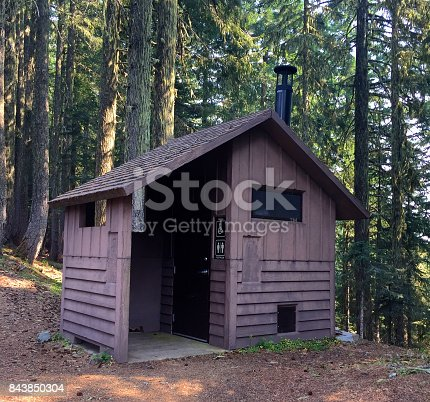 Vault toilet outhouse in the forest provided by the US forest Service