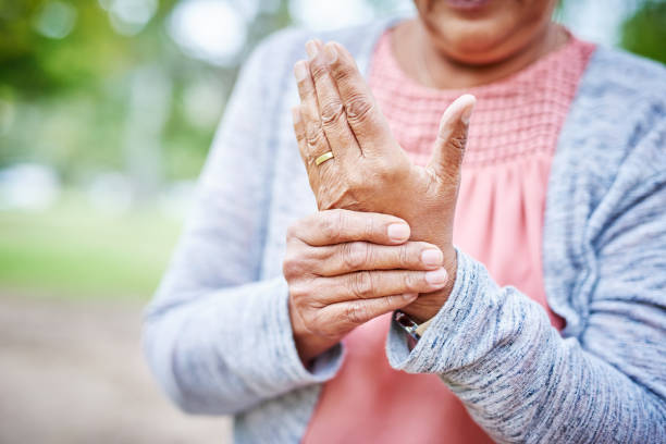 I've got arthritis in my hand Cropped shot of an unrecognizable senior woman suffering from arthritis in her hand while in the park alone arthritis stock pictures, royalty-free photos & images
