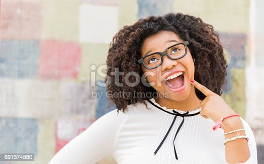 istock I've Got It! Lifestyle portrait of attractive young woman making a silly face. 691374580