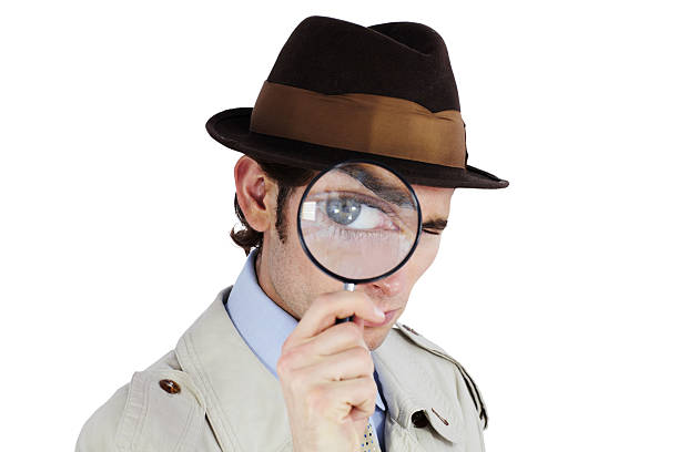 I've got my eye on you! Curious private investigator looking through a magnifying glass against a white background sherlock holmes stock pictures, royalty-free photos & images