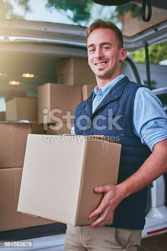 635967404 istock photo I've got your parcel safely right here 884563678