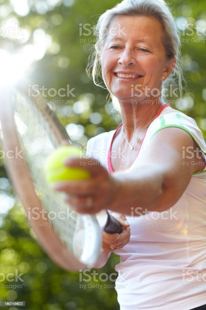 I've had years of practice to perfect my serve! stock photo