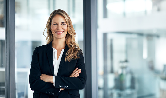 Shot of a confident young businesswoman standing in a modern office