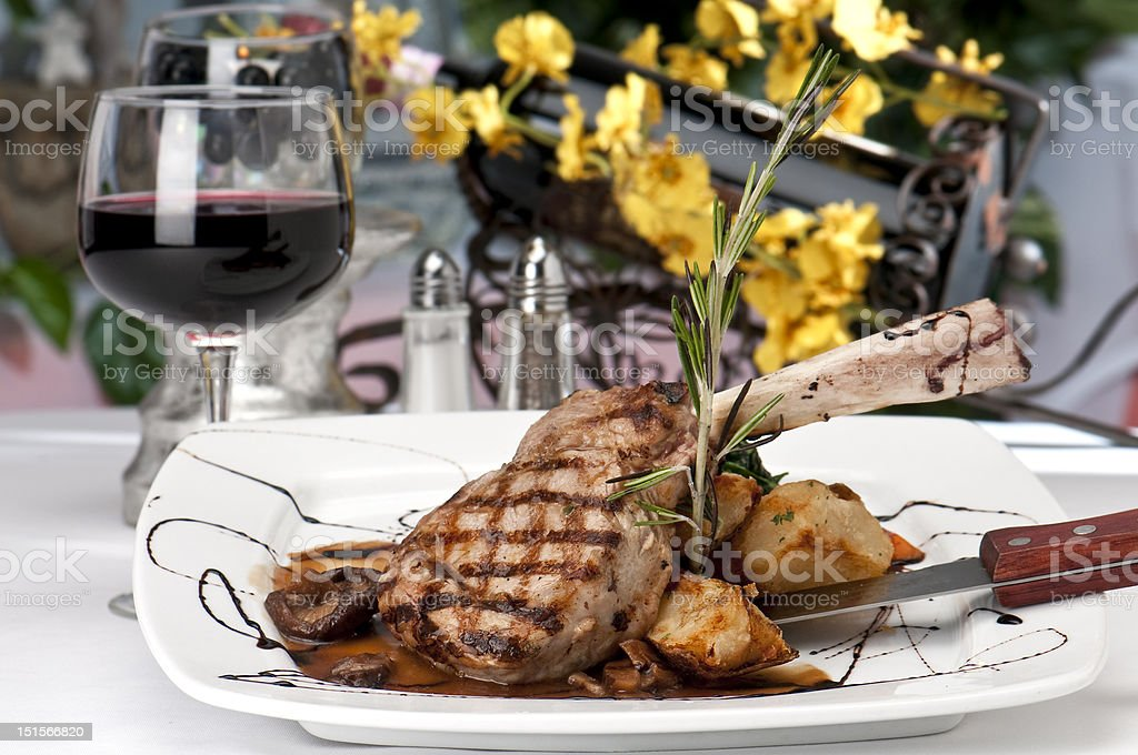 Veal Chop dinner and wine stock photo