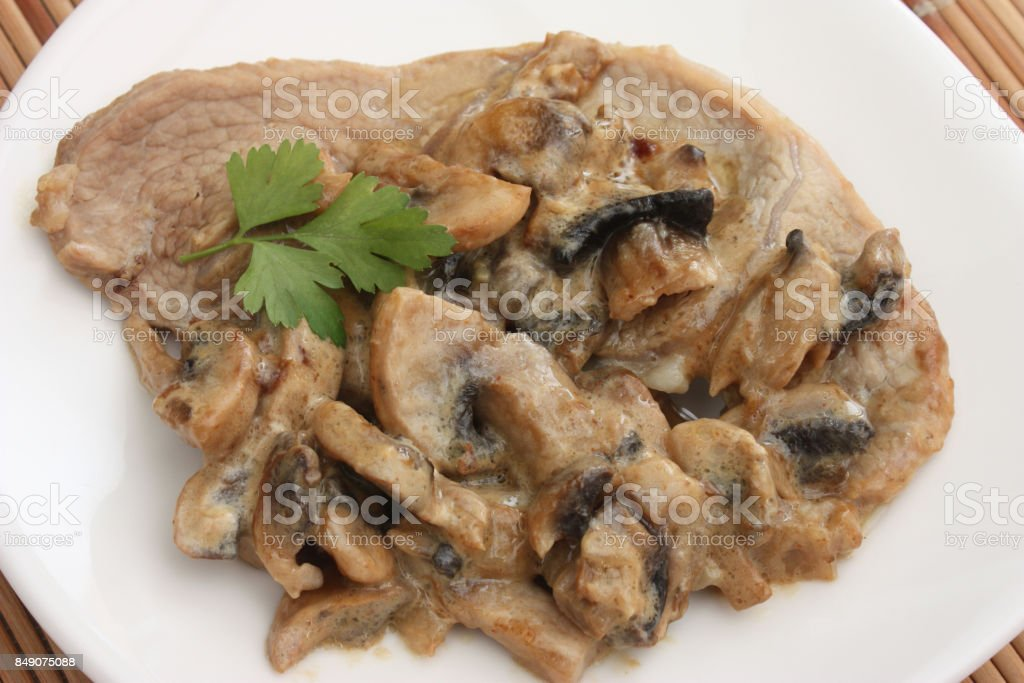 Veal escalope cooked in cream stock photo