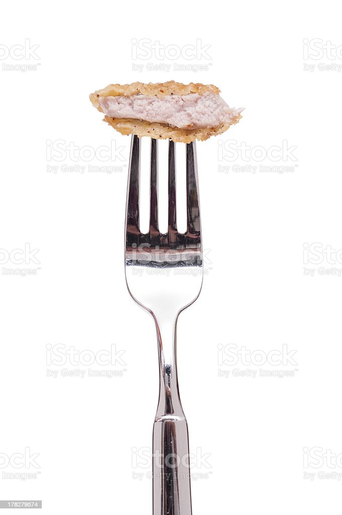 Veal escalope on a fork stock photo