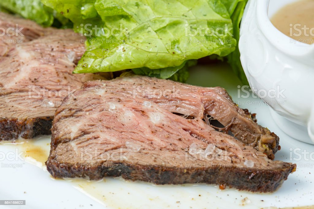 Veal slices and green vegetables royalty-free stock photo