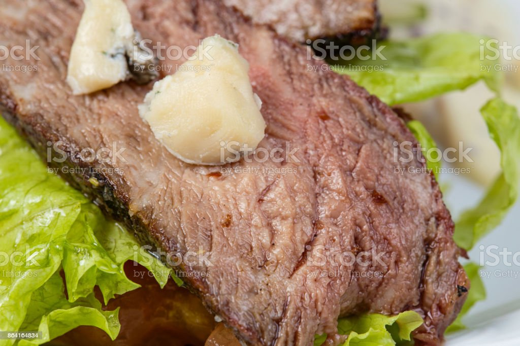 Veal slices of medium rare with vegetables royalty-free stock photo