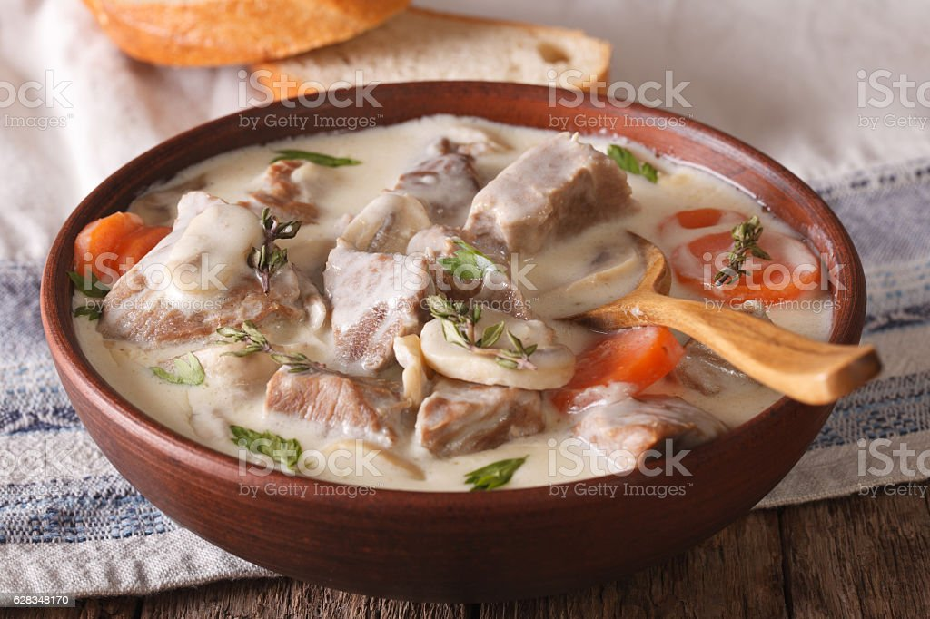Veal with mushrooms in cream sauce in a bowl. horizontal stock photo